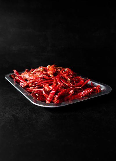 High angle view of red chili peppers in plate