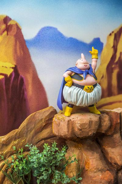 A Majin Buu toy on a rock formation. Great for toy cover. Anime Blue BUU Cute Day Dragonballz Lifestyles Majinbuu Mountain Rock Formation Still Life Still Life Photography Toy Toy Photography
