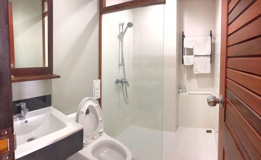 Look into the modern styled bathroom through the wooden door with knob. EyeEm Selects Bathroom Toilet Hygiene Indoors  No People White Color Domestic Bathroom Entrance Door Sink Home Household Equipment Flooring Mirror Convenience Tile Faucet