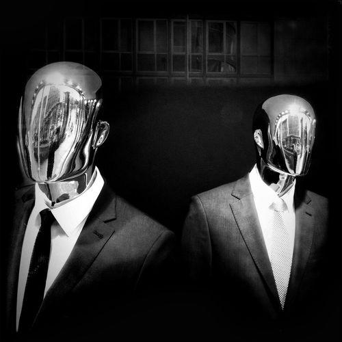 Close-up of mannequins against black background