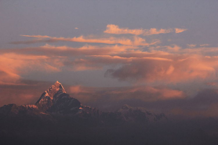 Sunrise twilight on cloud over the Machapuchare peak Sky Cloud - Sky Beauty In Nature Tranquil Scene Scenics - Nature Tranquility Nature No People Sunset Mountain Idyllic Orange Color Environment Non-urban Scene Outdoors Landscape Rock Mountain Peak Nepal Machapucharé Fish Tail Himalayas Himalaya Range
