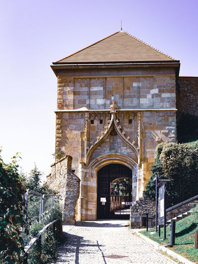 Entrance of historic building against sky