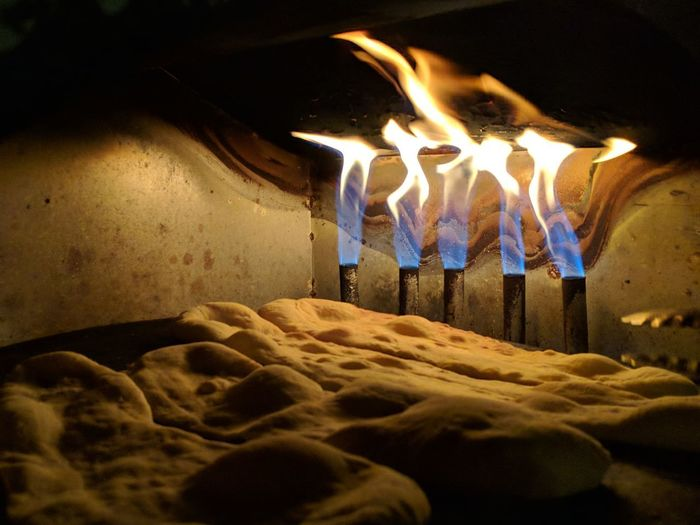 Burning Candle Close-up Fire Fire - Natural Phenomenon Fireplace Firewood Flame Glowing Heat - Temperature High Angle View Illuminated Indoors  Log Motion Nature Night No People Wood Wood - Material