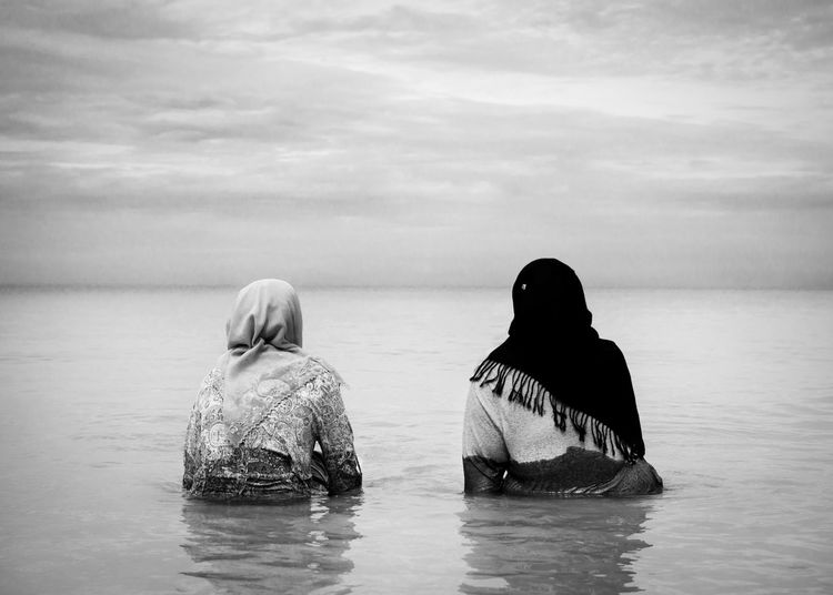 Beach Islam Burka  Bathing Black And White Sea Woman Adult Beauty In Nature Cloud - Sky Day Horizon Horizon Over Water Leisure Activity Lifestyles Muslim Nature Outdoors People Real People Rear View Scenics - Nature Sea Sky Tranquility Two People Water Waterfront Tranquility Nature The Traveler - 2018 EyeEm Awards