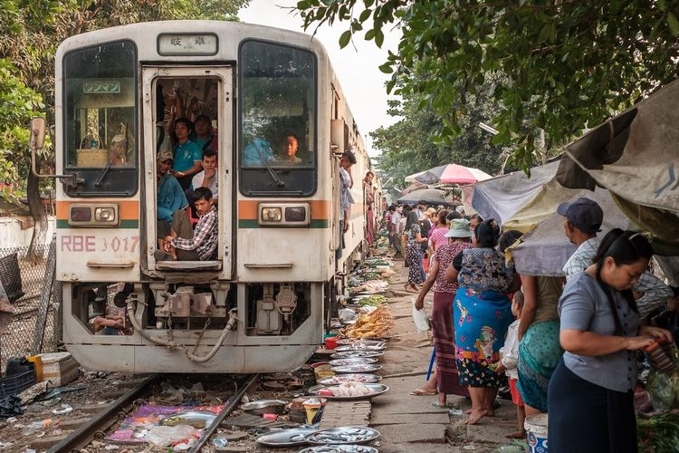 Market located at the Danyingone station of the Circular Railway of Yangon Myanmar. Amazing place!! Notice that merchants move from railway tracks as train passes leaving their merchandise in place. Myanmar Yangon Documentary Travel Market Railway Day Outdoors People Adult Men Adults Only
