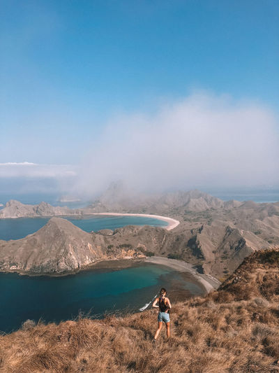 Komodo National Park, Flores Flores INDONESIA Komodo Komodo National Park Tourism Trip Girl Woman Walking View Nature Travel Blue Sea Mountains Clouds Mountain Scenics - Nature One Person Beauty In Nature Sky Leisure Activity Water Day Non-urban Scene Lifestyles Environment Adult Tranquility Rear View Real People Tranquil Scene Landscape Outdoors