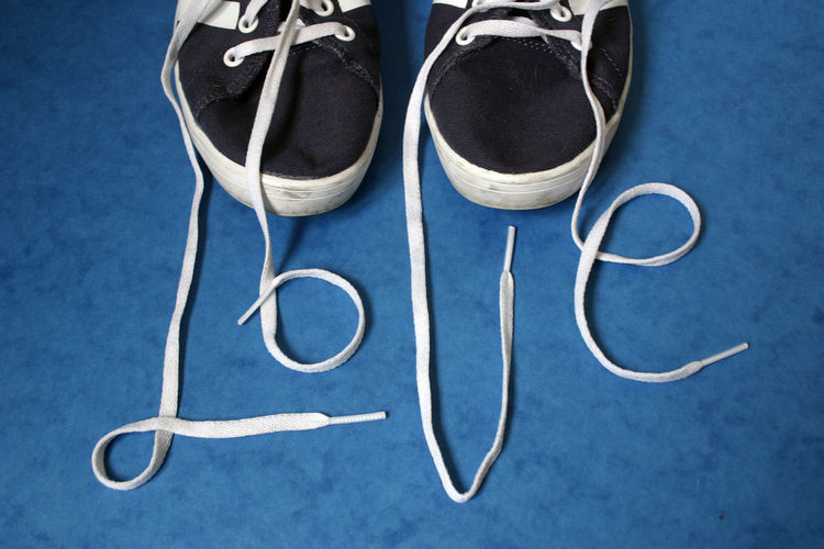 High angle view of love text made with shoelace on floor