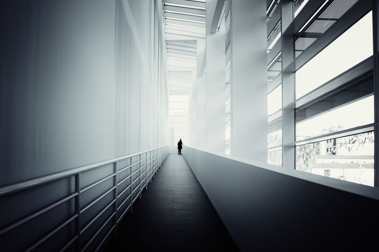 Man on staircase in building
