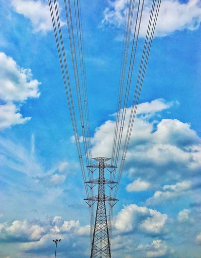 in the line Cable Cloud - Sky Electricity Pylon Sky Low Angle View Electricity  Power Line  Power Supply Day Connection No People Technology Outdoors Fuel And Power Generation Tall Sky And Clouds Clear Sky