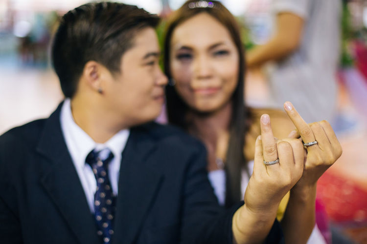 On Sunday, Ash (34) and Ghiea (29) show off their wedding rings at LGBT Mass Wedding in Quezon City, Manila. Although the same-sex marriage is not legally recognized in Philippines yet, there were 8 couples who joined the 5th year of same-sex holy union wedding organized in Manila. Eyeem Philippines Filipino Lgbt Lgbt Wedding LGBTQ Rights Loveislove Lovewins Manila Photojournalism Pride2016 Showcase June Transman Wedding EyeEm Diversity Resist The Photojournalist - 2017 EyeEm Awards This Is Queer This Is Family Focus On The Story Love Is Love A New Perspective On Life