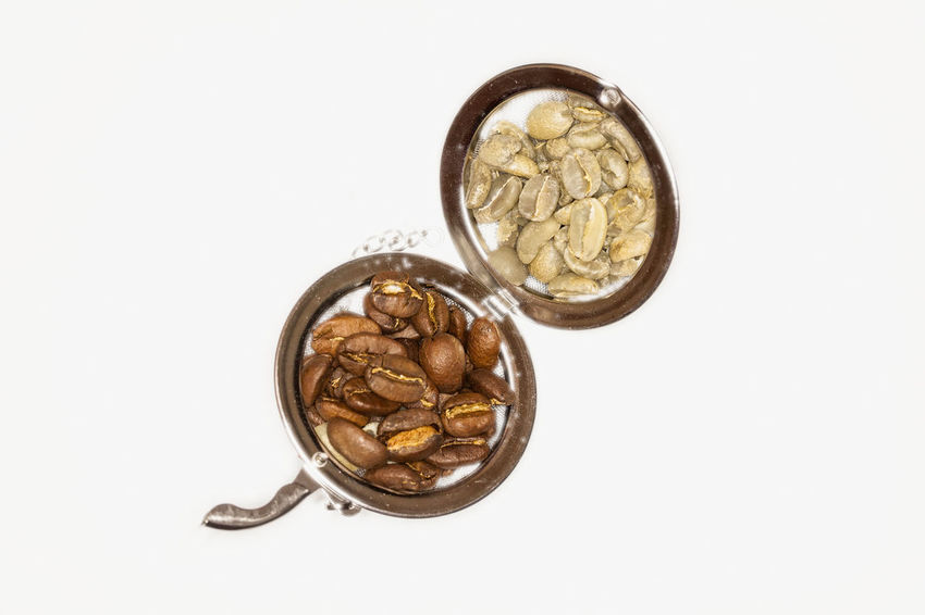 Close Up Of Raw And Roasted Coffee Beans On A White Background Arabic Backdrop Background Beans Beverage Close Up Close-up Closeup Coffee Time Coin Detail Fresh Freshness Gourmet Healthy Eating Mixture  No People Nutshell Raw Food Seed Texture Unprocessed Vegan Vegetarian White Background