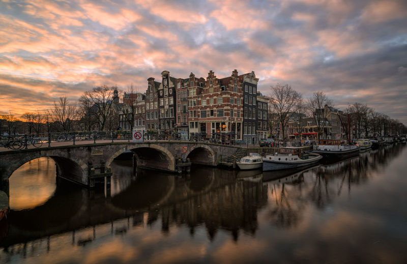 Amsterdam cityscape, Brouwersgracht Tourist Destination Travel Destinations Urban Historical Building Canal Houses No People Canals Amsterdam Amsterdam Canal Amsterdamcity Holland Netherlands Long Exposure Bridge - Man Made Structure Reflection Sunset Dusk Water Travel Destinations No People Cityscape Architecture Sky City Outdoors Day Colour Your Horizn