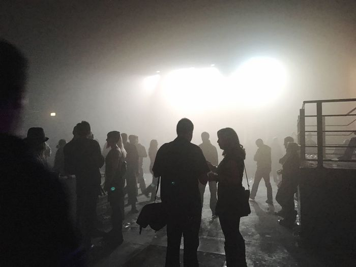 Arts Culture And Entertainment Leisure Activity Large Group Of People Darkness And Light Fog Concert Audience People People Watching