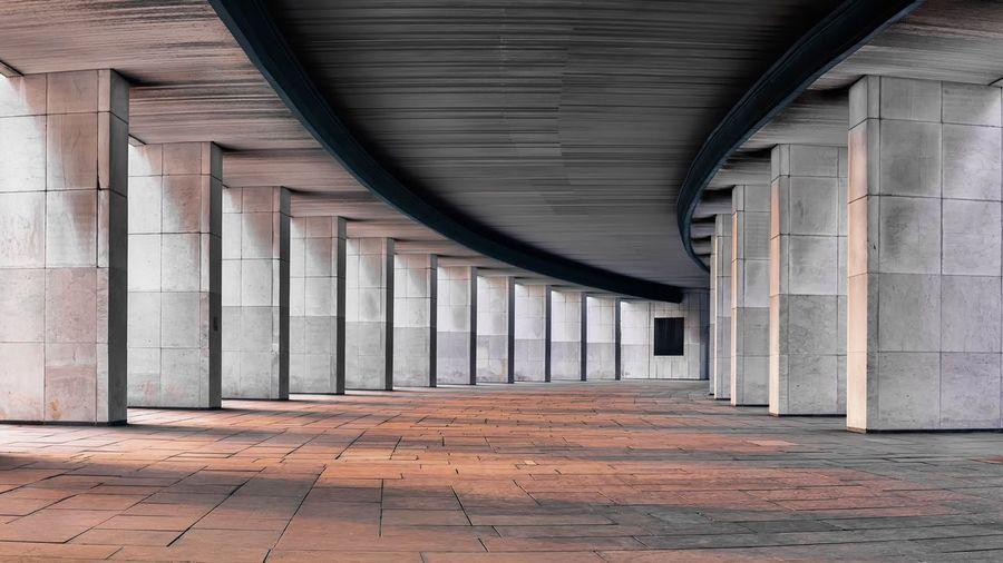 Empty corridor amidst columns