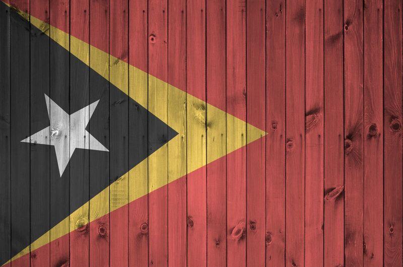 Full frame shot flag on wooden wall