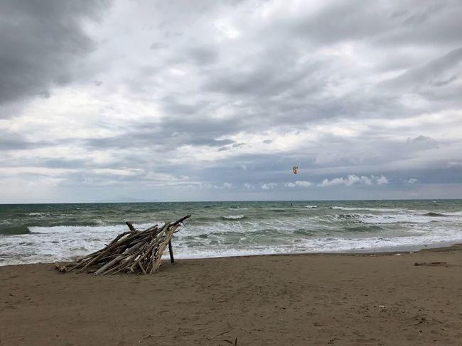 No People Nature Green Color Outdoors Day Beauty In Nature Sand Sky Water Cloud - Sky Scenics Wave Tranquility Sea Beach Horizon Over Water Shore primo maggio