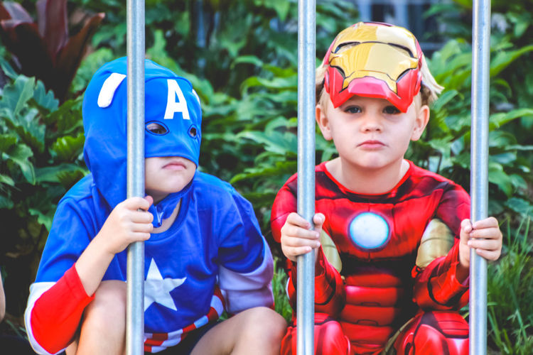 Superhero Blue Boys Child Childhood Costume Day Friendship Front View Holding Innocence Leisure Activity Looking At Camera Males  Men Outdoors People Portrait Real People Sitting Three Quarter Length Togetherness Two People The Portraitist - 2018 EyeEm Awards