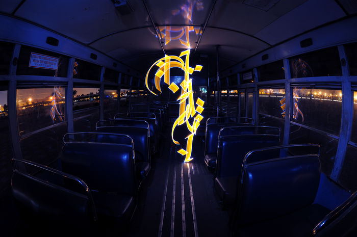 Abstract Light Graffiti or light painting using Arabic calligreaphy inside an abandon bus facing the street (using led lights and slow shutter photography) Arabic Calligraphy Bulgaria Bus Calligraffiti Calligraphy Illuminated Industry Landscape LED Light Led Lights  Light Graffiti Light Painting Motion Motion Light Perspective Public Transportation Seat Slow Shutter Vehicle Interior Vehicle Seat