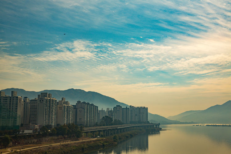 crossing Han river by bus on the way to Sokcho Han River Riverside Seoul Seoul, Korea Architecture Beauty In Nature Building Exterior Built Structure City Cityscape Cloud - Sky Day Mountain Nature No People Outdoors River Scenics Sky Sunset Water