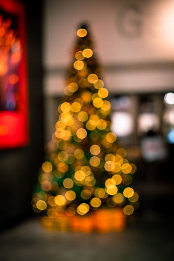 Bokeh lights of a Christmas tree shot out of focus Christmas christmas tree Holiday Celebration Christmas Decoration Light Illuminated Christmas Lights No People Bokeh Blurred