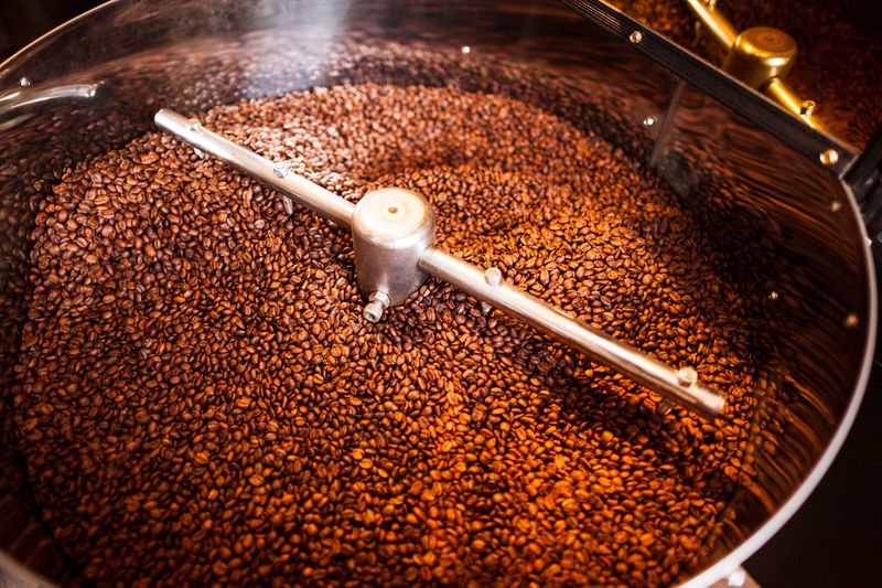 High angle view coffee beans in coffee grinder