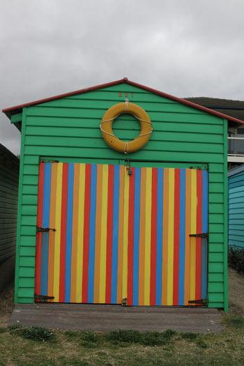 Multi Colored Beach Hut Against Sky