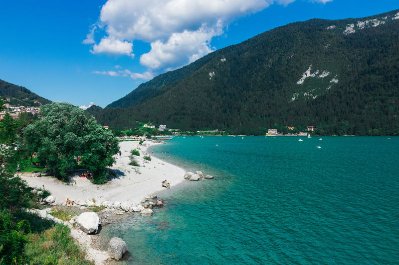 Scenic view of molveno lake and mountains against sky