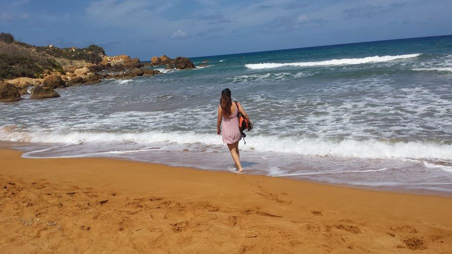 #ramlabay #gozo #malta #redsand #redsand #sandybeach Adult Beach Beauty In Nature Day Full Length Horizon Over Water Leisure Activity Lifestyles Motion Nature One Person Outdoors People Sand Scenics Sea Sky Surf Water Wave