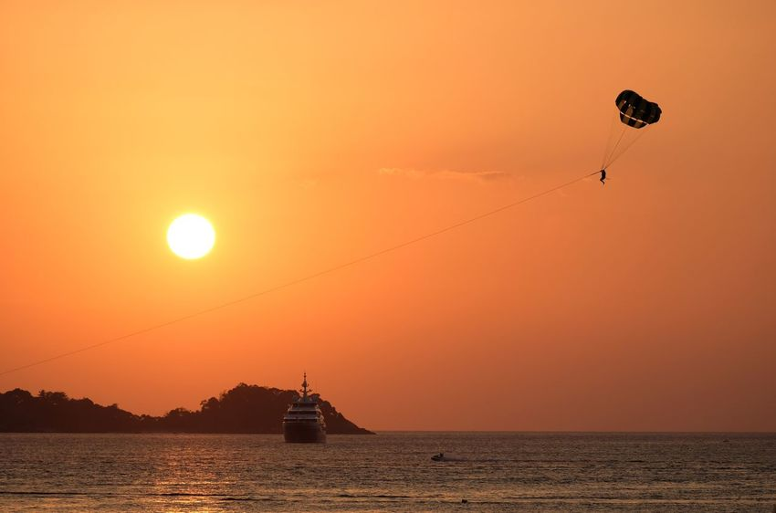 Before sunset Sunset Adventure Parachute Leisure Activity Sea Sky Sun Extreme Sports Silhouette Outdoors Scenics Flying Mid-air Nautical Vessel Transportation Waterfront Water Real People Nature Lifestyles
