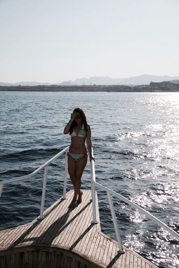 Beautiful Woman Beauty Beauty In Nature Bikini Egypt Full Length Horizon Over Water Leisure Activity Lifestyles Nature Nautical Vessel One Person Outdoors Portrait Real People Scenics Sea Standing Summer Vacation Water Yachting Young Adult Young Women