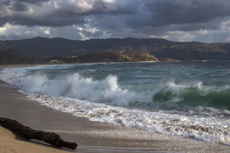 view over sea and beach in sagone corsica Bourbonne-les-Bains Beach Beauty In Nature Bridge Clouds And Sky Corsica Day Force Motion Mountain Nature No People Outdoors Power In Nature Sagone Sagone Corsica Scenics Sea Shaddow And Light Sky Sunset Water Wave Waves, Ocean, Nature