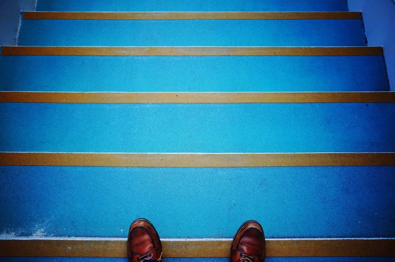 Low section of person on blue steps