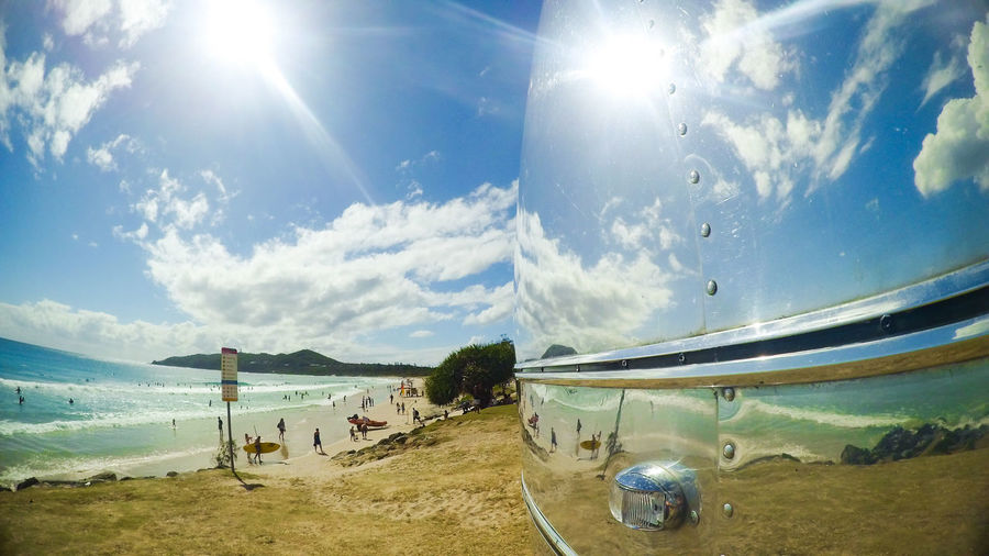 Beach Beauty In Nature Bus Caravan Chrome Cloud - Sky Day Fish-eye Lens Lens Flare Nature No People Outdoors Polished Reflection Sand Scenics Sea Shiny Sky Sun Sunbeam Sunlight Tranquility Water