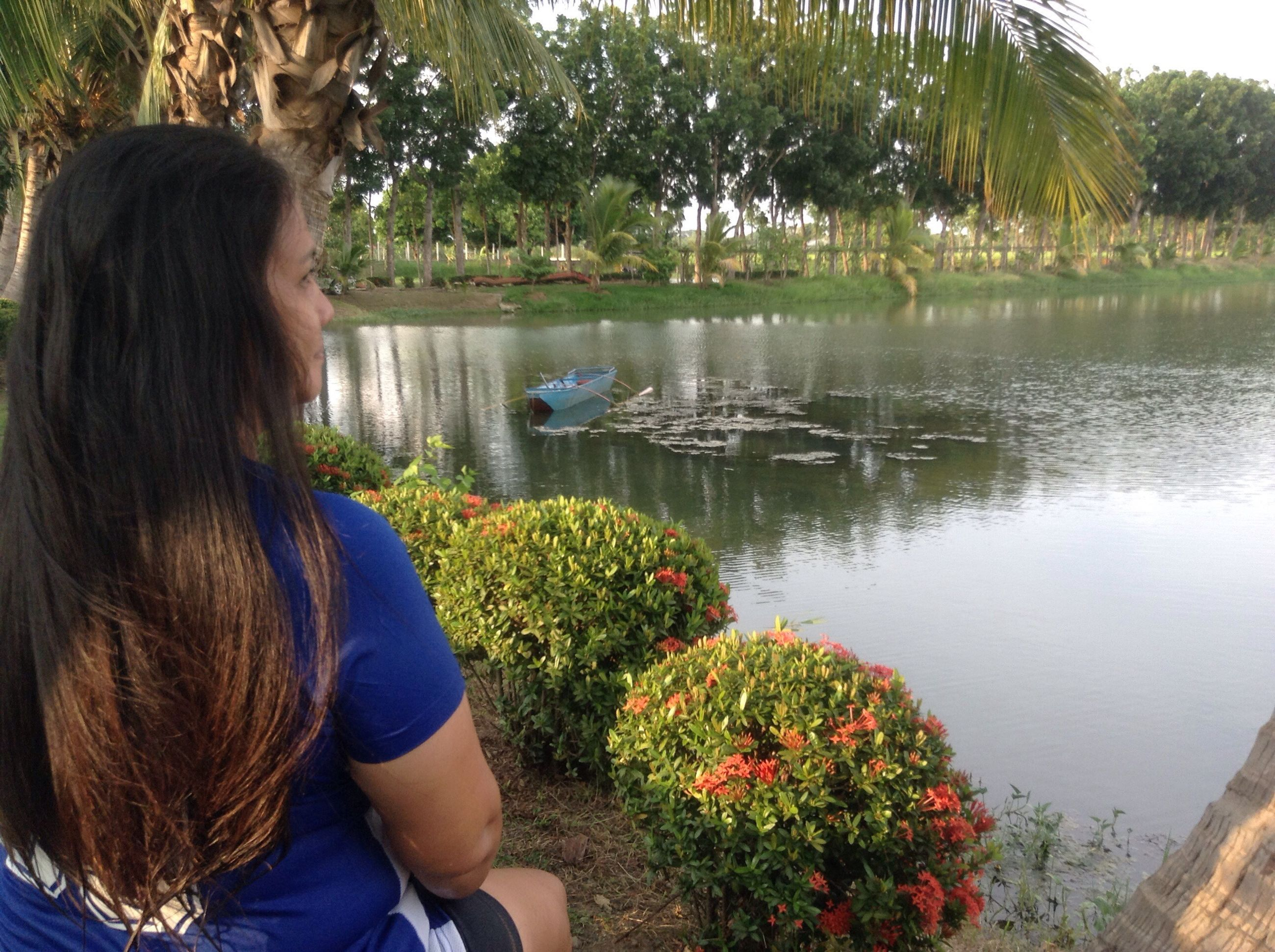 real people, one person, water, nature, flower, plant, day, rear view, outdoors, long hair, lake, leisure activity, women, lifestyles, beauty in nature, tree, growth, young women, young adult
