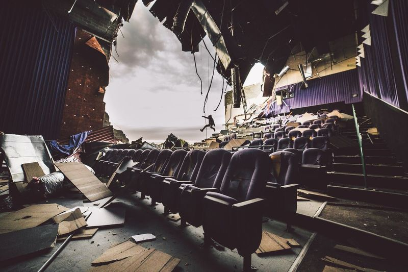 Man jumping in abandoned theater