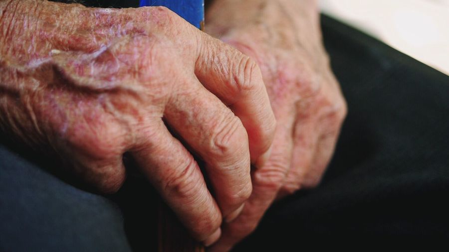 Cropped image of woman with wrinkled hands