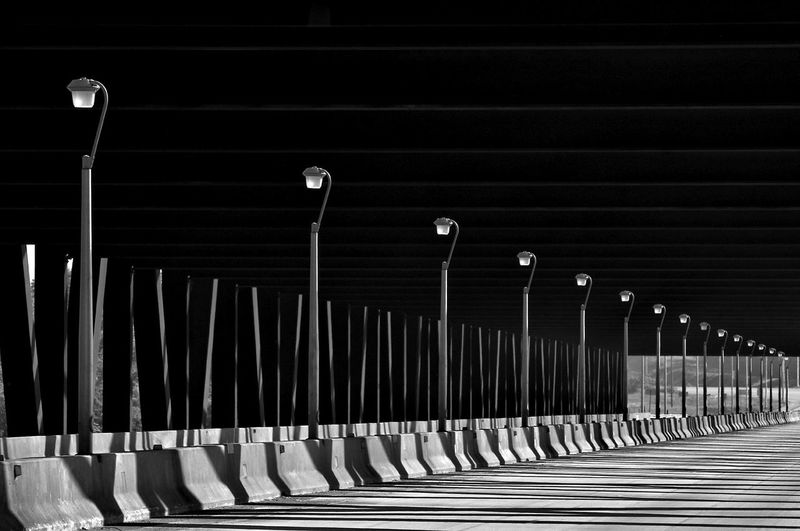 Absence Black&white Black&white Photography Dark Diminishing Perspective Electric Lamp Electric Light Empty Fine Art Photography Illuminated In A Row Light Lighting Equipment Long Night No People Patterns Repetition Road Side By Side The Way Forward Vanishing Point