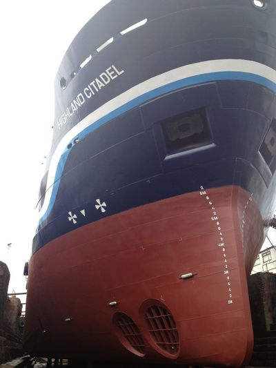 Dry Dock Anchors Anodes Built Structure Capital Letter Clear Sky Day Draught Marks Low Angle View Mode Of Transportation No People Outdoors Red Ship Repair Ships Hull Sky Technology Text Transportation Travel Tunnel Thruster