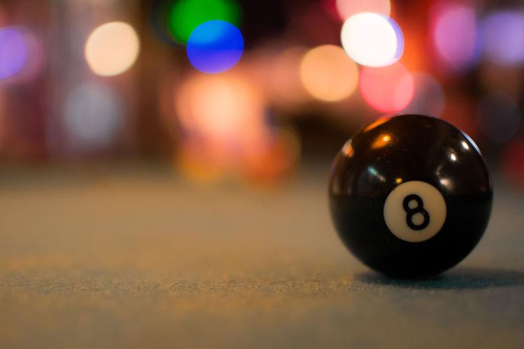 Close-up of pool ball on illuminated street