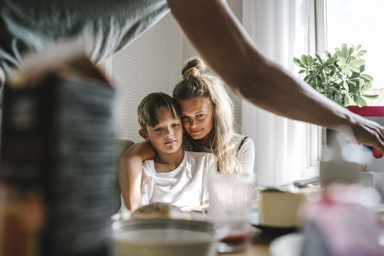Mother and daughter on table at home