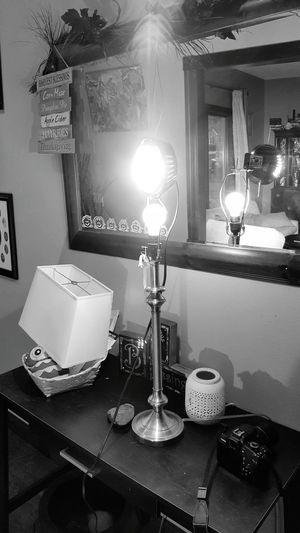 Illuminated lamp on table in house