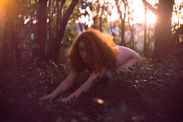 Naked woman in forest