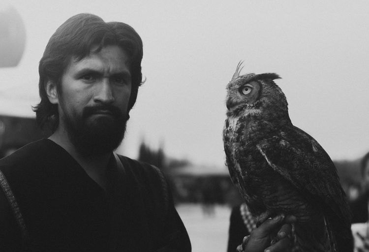Pet Portraits Bird Animal Themes People Indoors  Adult Only Men One Person Day One Man Only Adults Only Bird Of Prey Sky Young Adult Human Hand The Week On EyeEm