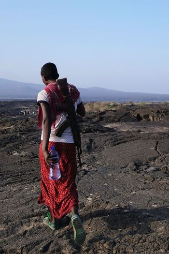 Ethiopia Africa Vulcanic Lava Guard Afar Erta'ale Vulcano Danakil Depression Standing Rear View Young Women Desert Full Length Sand Sky Arid Landscape The Photojournalist - 2019 EyeEm Awards