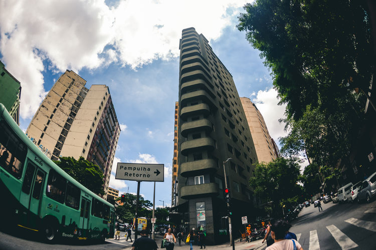 Panoramic view of city street against sky