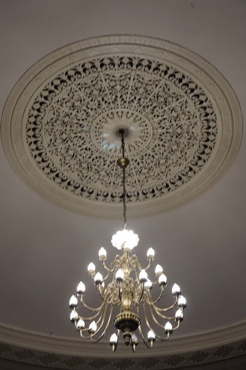 Grand chandelier in a small theater. Antique Theater Built Structure Ceiling Chandelier Fixture Illuminated Indoors  Lighting Equipment Low Angle View No People Ornate Plaster