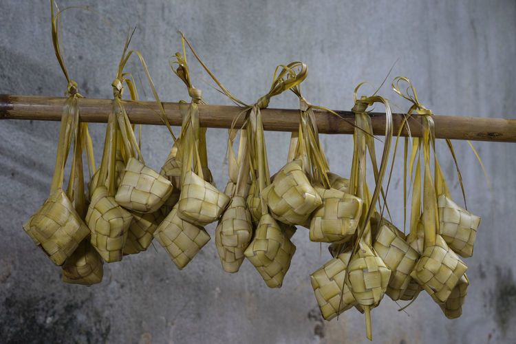 Ketupat is a natural rice casing made from young coconut leaves for cooking rice.