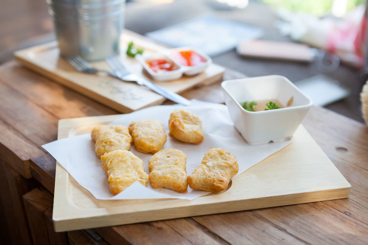 Chicken nuggets and sauce on a wooden background. Close-up Day Focus On Foreground Food Food And Drink Freshness Healthy Eating Homemade Indoors  No People Ready-to-eat Table