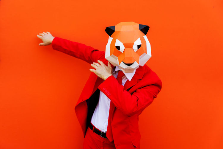 View of red toy against orange background