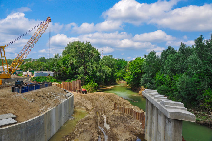 Construction of the bridge Cloud - Sky Sky Tree Outdoors Water Nature Architecture Construction Bridge Build Building Structure Construction Work Construction Industry Construction Crane Working Work